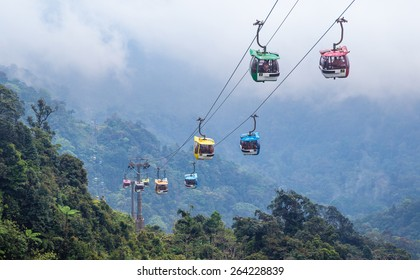 Cable car ferrying passengers up and down the mountain.