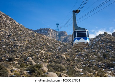 Cable Car gondola above albuquerque in the Remarkable Mountains of Sandia Peak.