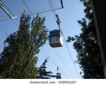Cable car in Madrid between trees