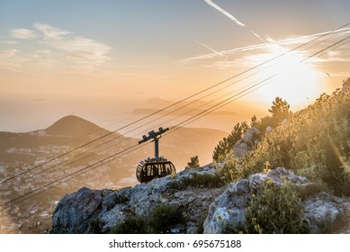 Cable car moving to the summit of Mount Srd for tourists to enjoy the view of Dubrovnik, Croatia during sunset