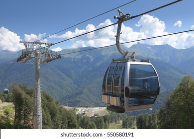 The cable car on a background of mountains
