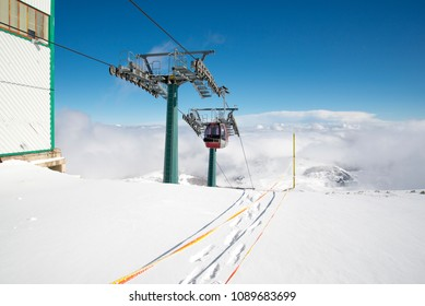 Cable car on snowy mountain top in Roccaraso, Italy
