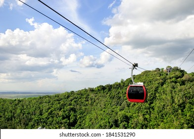 Cable car overlooking beautiful green hills at Hat Yai Municipal Park in Hat Yai, Songkhla Province, Thailand.