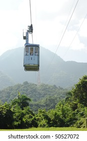 Cable car passing over jungle forest in Dominican Republic