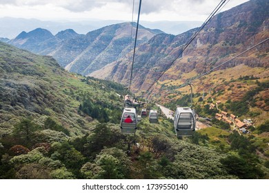 Cable Car takes tourists up to Jiaozi snow Mountain. Tourist attractions of Yunnan with beautiful nature,Kunming,China