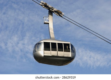 A cable car, tram, travels through the sky.