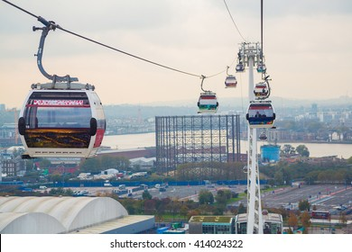 Cable cars from Emirates going above Thames river in London