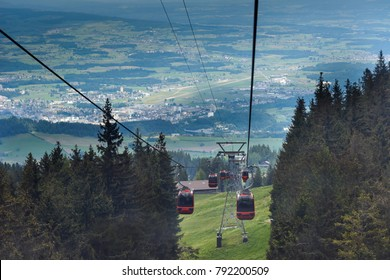 Cable Cars plying to and fro ferrying tourists up and down Mt Pilatus in Switzerland.
