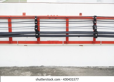 Cable and electric wire are neatly arrange on the wall on the rooftop.
