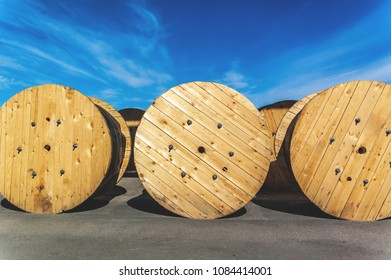 Cable factory, large wooden bobbins with cable