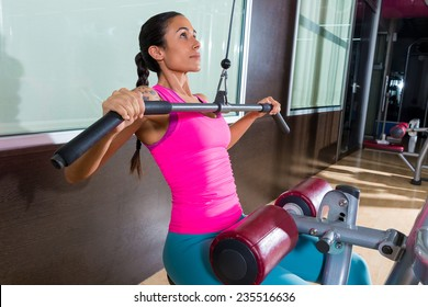 Cable Lat pulldown machine woman workout at gym exercise