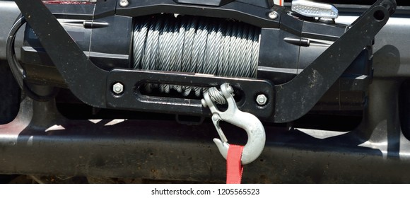 Cable on emergency vehicle winch with heavy hook