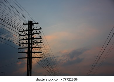 cable pole in train station with sun set sky background