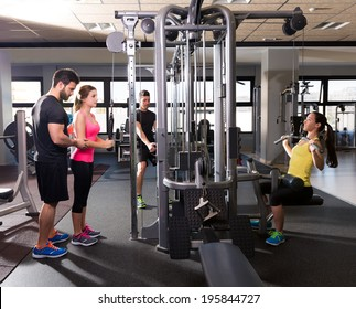 cable pulley system gym workout fitness people with personal trainer