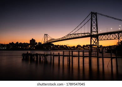 Cable stayed bridge Hercilio Luz in Florianopolis, Santa Catarina, Brazil, at sunset with colorful sky and silhouette of the structure