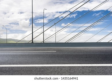 Cable stayed bridge and road ground under the sun