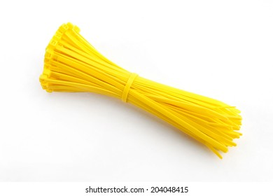 Cable tie in yellow on white background