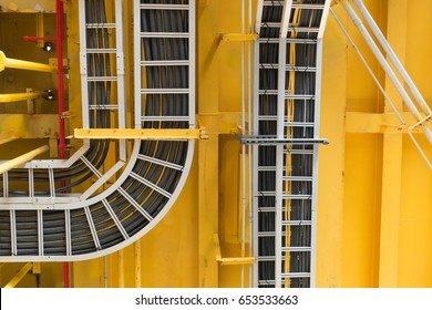Cable tray with electrical wiring arranged on ceiling at offshore platform.