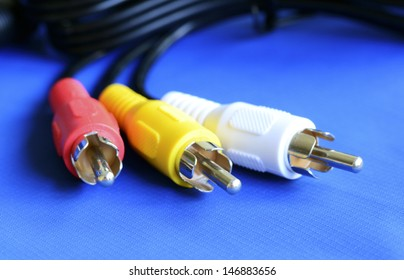 Cable to the TV isolated on blue concept of entertainment and communication
