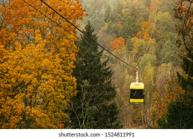 Cablecar Sigulda and Thick colourful forest in autumn season in Gauja National Park, Sigulda, Latvia.