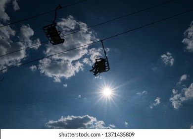 Cablecars with people against sunlight in Boppard