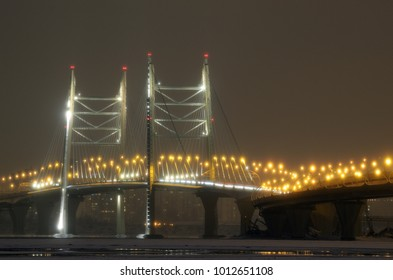 Cable-stayed bridge at night.In the darkness shines the electric light.