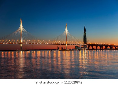 Cable-stayed bridge of Western high-speed diameter through Peter's fairway and the tower of Lakhta center, at sunset, Saint-Petersburg, Russia