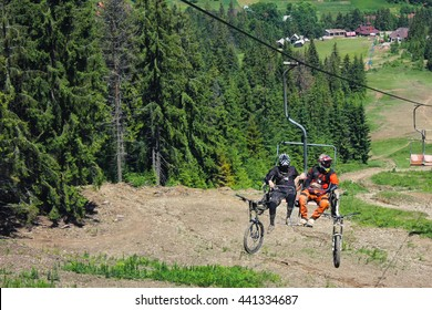 Cableway carrying mountain bikes at summer mountains background