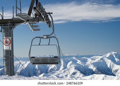 A cableway on a ski resort on a snowy mountain.
