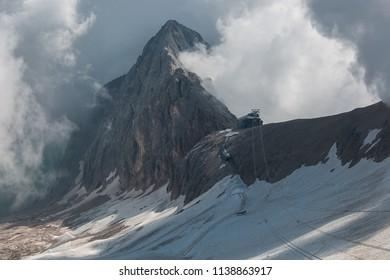 Cableway to Punta Penia peak, Marmolada glacier, Dolomites, Italy