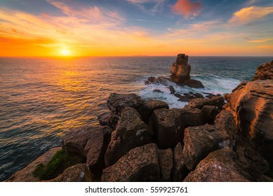 The Cabo Carvoeiro rocky coast in Portugal / The Cabo Carvoeiro / Magical sunset at The Cabo Carvoeiro in Portugal