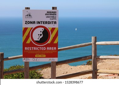 Cabo da Roca, Sintra , Portugal - September 2019: Danger zone restricted area sign at the coast