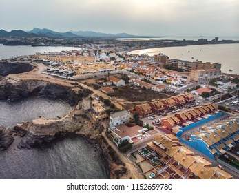 Cabo de Palos, cape in the Spanish municipality of Cartagena, in the region of Murcia. Small spanish village, drone arial panoramic photo. Summer 2018