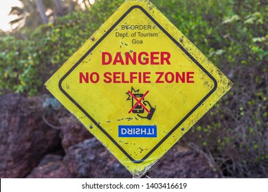 Cabo de Rama, Goa / India - May 20 2019: A sign warning visitors from taking selfies on the rocks.