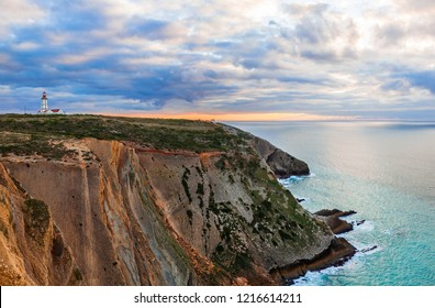 The Cabo Espichel Cape, with the 18th century lighthouse and a view over the Atlantic Ocean during sunset. Sesimbra, Portugal