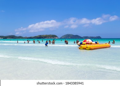 CABO FRIO, RIO DE JANEIRO, BRAZIL - DECEMBER 26, 2019: Panoramic view of Praia do Forte beach in the town. White sand, clear and transparent water of sea. Many people enjoying of the sunny day.