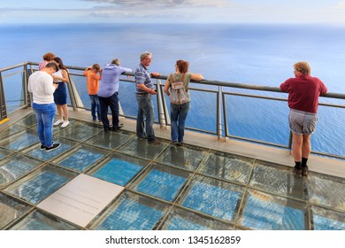 CABO GIRAO, MADEIRA - OCTOBER 11, 2015: Tourists looking at the view at the Cabo Girao platform, a viewpoint on top of the big cliffs of the island Madeira, on October 11, 2015