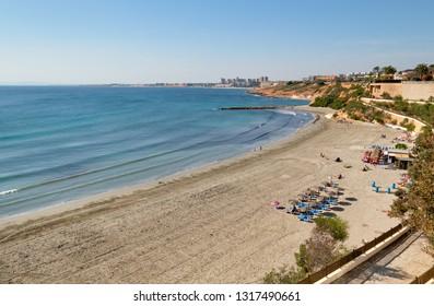 Cabo Roig sandy beach at winter time. Mediterranean sea, sunny day, Orihuela Costa above view, Province of Alicante, Costa Blanca, Spain
