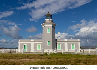 The Cabo Rojo Lighthouse or Faro Los Morrillos de Cabo Rojo against the blue sky in Puerto Rico