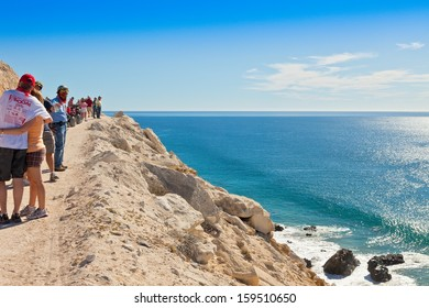 CABO SAN LUCAS, MEXICO - FEB. 12:  Visiting ATV drivers stop along side a cliff overlooking the Sea of Cortez on Los Cabos shoreline on Feb. 12, 2011.
