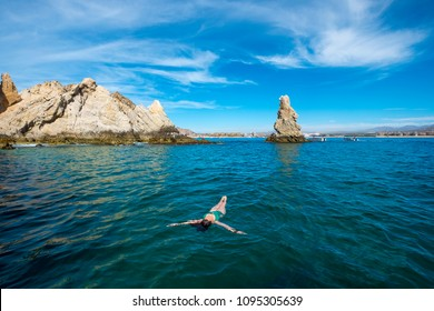 Cabo San Lucas, Mexico - March 12, 2018: a tourist relaxing in the coast of Los Cabos
