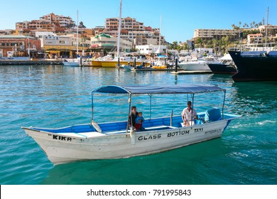 CABO SAN LUCAS, MEXICO -MARCH 20, 2012 : View on Cabo San Lucas marina and travel boats, popular touristic destination on Baja California, Mexico. Holiday travel port in Mexico