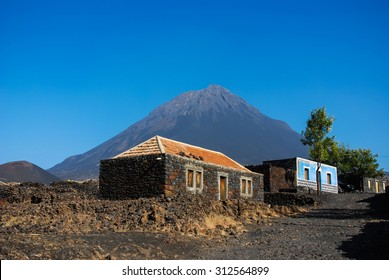 Cabo Verde, Pico do Fogo, Caldera. Volcano Pico do Fogo, 2829 m, the highest mountain of Cabo Verde standing isolated in the burned Lava fields. Hauses of igneous rocks in the Cha das Caldeiras.