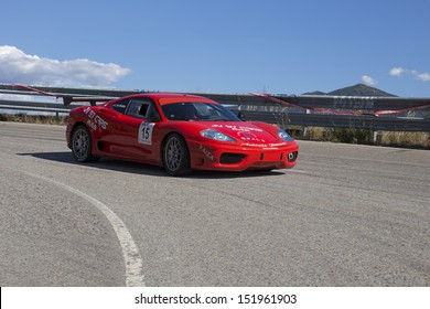CABOALLES-SPAIN - AUGUST 17: Javier Jimenez drives a Ferrary 360 Modena car during Leitariegos hill climb rally,castilla-leon championship on august 17, 2013 in caboalles,Spain.