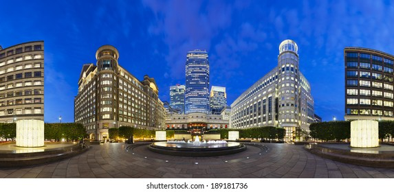 Cabot Square panorama in the modern Canary Wharf quarter with its banks and skyscrapers at night