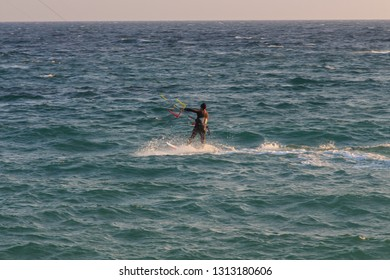 Cabrera de Mar,Barcelona/Spain; 02 08 2019: A good afternoon to practice Windsurfing and Kitesurfing (Flysurf) at Cabrera beach at sunset with the waves of the sea at your point.