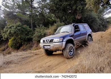 CABRIERES, FRANCE - OCTOBER 14: A Nissan Patrol in action in the dirt roads of a trial track, october 14, 2017.