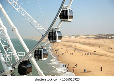 Cabs of a Ferris wheel on the North Sea beach.