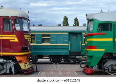 Cabs of modern Russian electric trains. Side view of the heads of railway trains with a lot of wheels and windows in the form of portholes