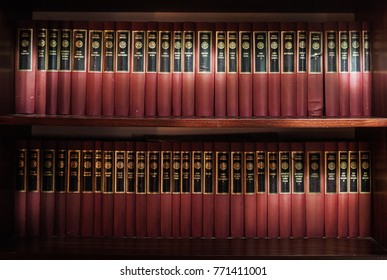 Cacak, Serbia - December 07, 2017: Closeup view of books of old Serbian literature on shelves. Famous writers and heritage collections.